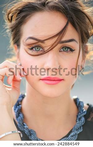 Urban outdoor portrait of yang beautiful woman. - stock photo