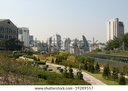 Urban Park and Seoul City Skyline - stock photo