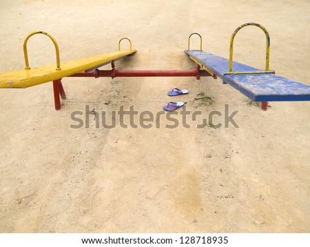URBAN PLAYGROUND TOYS - OUTDOORS - FORGOTTEN CHILDREN SANDALS - stock photo