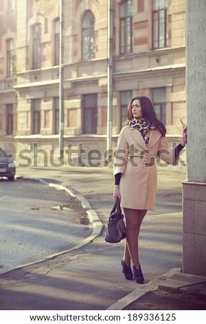 Urban portrait of a beautyful brunette - stock photo