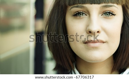 urban portrait , selective focus on eye (left part of image, special toned) - stock photo