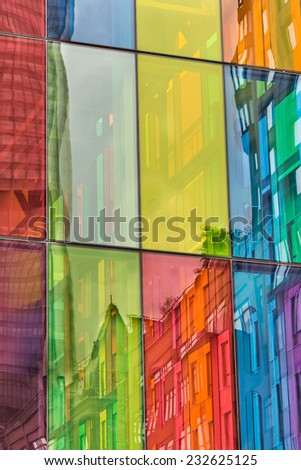 Urban reflections on colored windows of Montreal Convention Center - stock photo