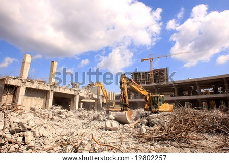 Urban renewal in the city centre. Digger working during dismanling - stock photo