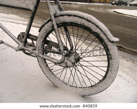 Urban retro bike covered with snow.