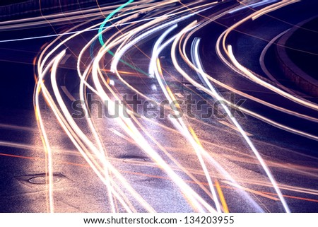 Urban road car light trails - stock photo