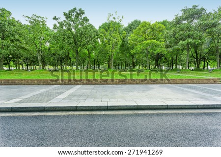 urban road with green trees - stock photo