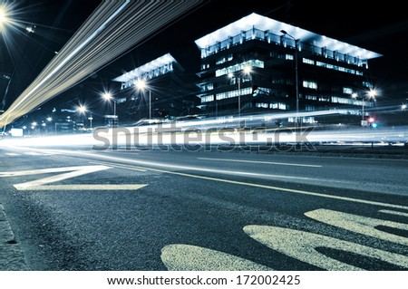 Urban scene at night in the long exposure from low angle  - stock photo