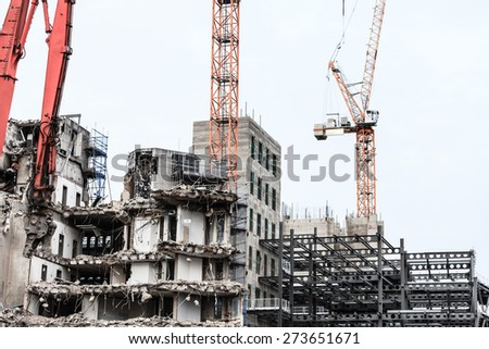 Urban scene. Dismantling of a house. Building demolition and crashing by machinery for new construction. Industry. - stock photo