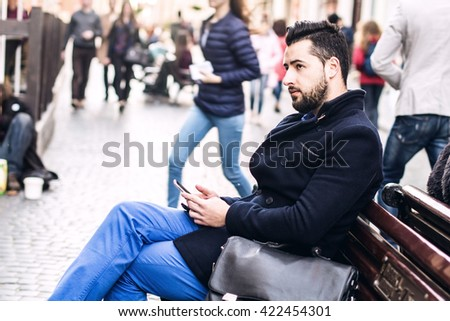 Urban scene with a stylish young man - stock photo