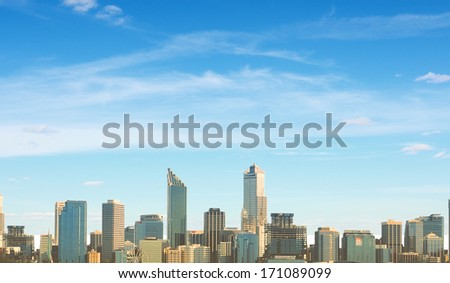 Urban scene with buildings and skyscrapers in sunlight - stock photo