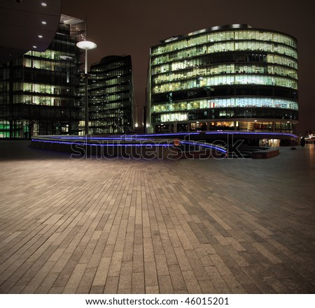 Urban scene with offices at night - stock photo