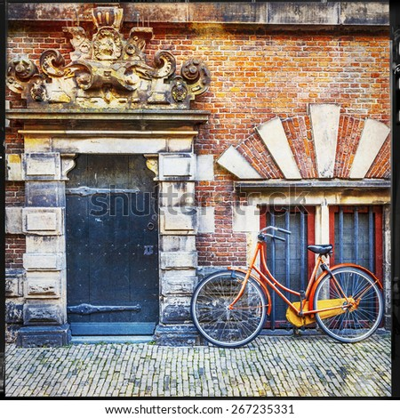 urban scenery of Holland. old door with bisycle - stock photo