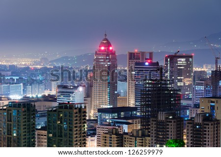 Urban scenery with skyscrapers and apartments in night, Taipei, Taiwan.