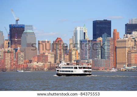 Urban skyscrapers and boat from New York City Manhattan downtown over river. - stock photo