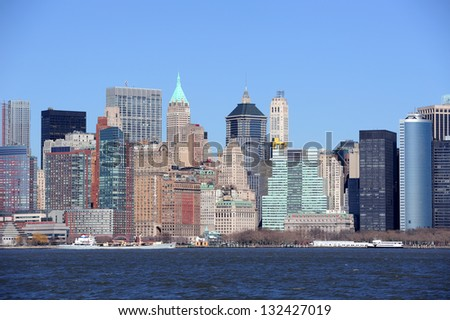 Urban skyscrapers of New York City Manhattan downtown over river. - stock photo