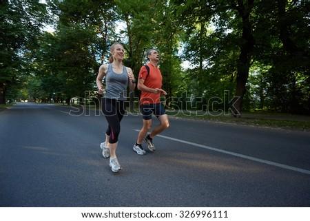urban sports healthy couple jogging - stock photo