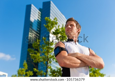 Urban sports - young man is doing fitness in the city on a beautiful summer day