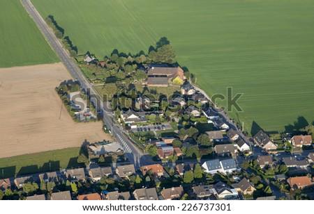 Urban sprawl in the Lower Rhine Region of Germany - Aerial view of Rheinberg, North Rhine-Westfalia, Germany, Europe - stock photo
