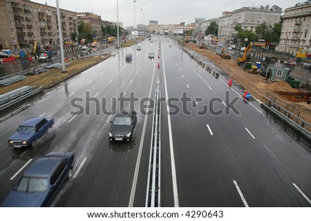 Urban street in rainy day - stock photo