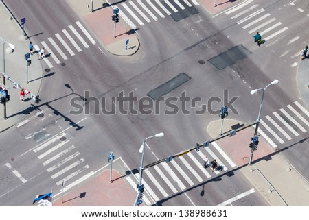 Urban street traffic and pedestrian crossing - aerial view
