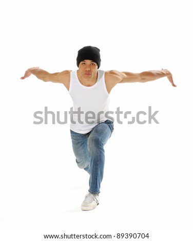 Urban style street breakdancing handstand grab move done isolated on white in studio - stock photo