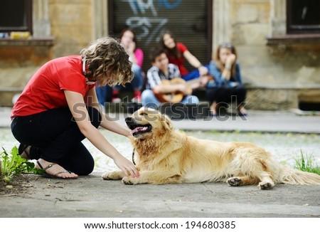 Urban stylish trendy young teenage people with dog - stock photo