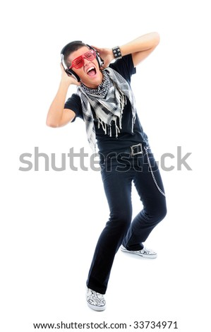 Urban teenager listening music and dancing, isolated on white - stock photo