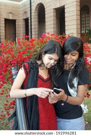 Urban teenagers on phone. - stock photo