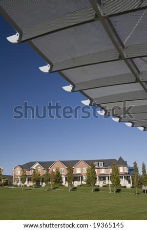Urban townhouses and beautifully design park - stock photo