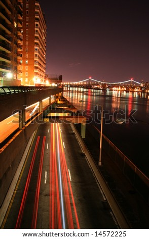 Urban Traffic at Night on FDR Drive in New York City - stock photo