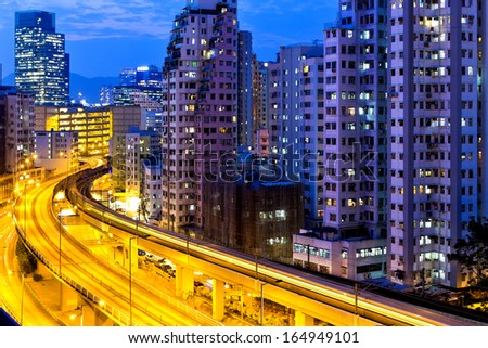 Urban traffic at night with modern buildings