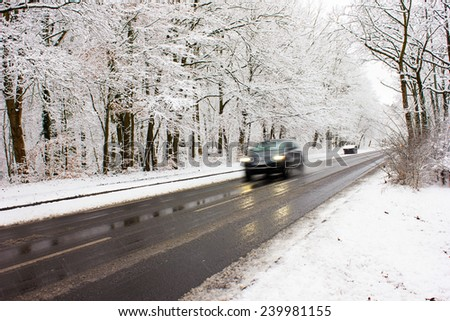 Urban Traffic in Winter with Snow Covered Street
