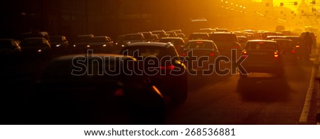 Urban traffic jam at the evening, sunlight - stock photo