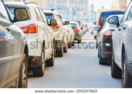 urban traffic jam in a city street road during evening rush hour  - stock photo
