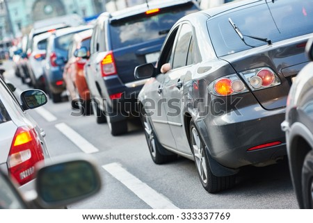 Urban traffic jam in a city street road during rush hour - stock photo