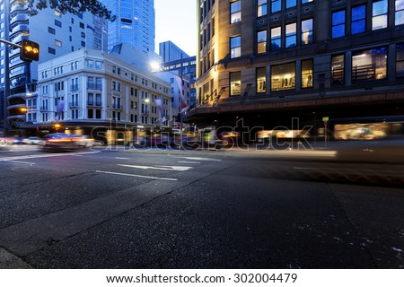 Urban traffic light trails - stock photo