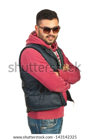 Urban trendy man standing in semi profile with arms folded isolated on white background