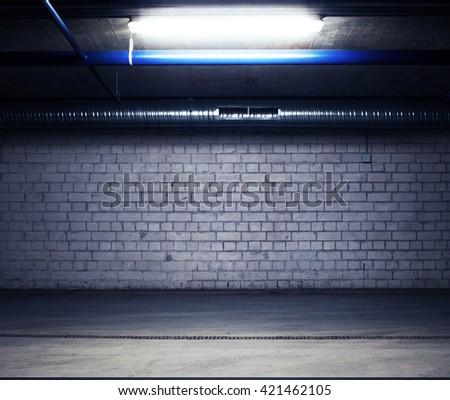 Urban underground background. Brick wall under the lamp light in the dark - stock photo