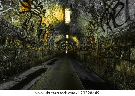 Urban underground tunnel  with light - stock photo