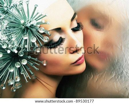 Urbanization. Beautiful fashion model sensual female reflects in mirror. Haute couture - stock photo