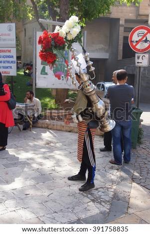 URFA, TURKEY - JUN 8, 2014 - Traditional water seller  in Urfa bazaar,  Turkey - stock photo