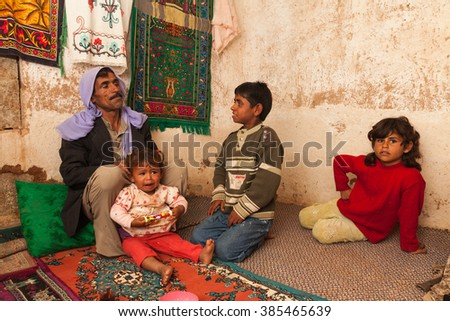 Urfa, Turkey - September 20, 2009 : Seasonal workers at home in Harran province near the Syrian border of Turkey.The ethnicity of the region is diversified.Arabs, Kurds and Turks live together.