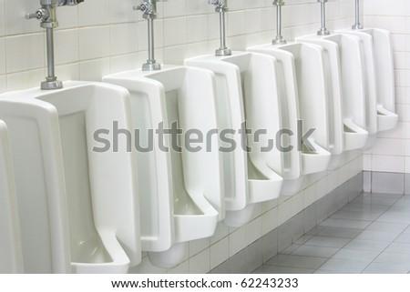 urinal man clean toilets - stock photo