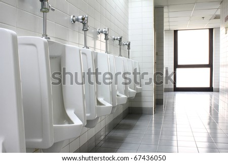 urinal man clean toilets - stock photo