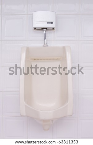 Urinal man toilets - stock photo