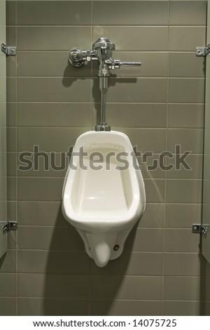 Urinal mounted on wall - stock photo