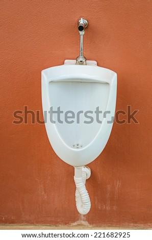 Urinals in public toilet - stock photo