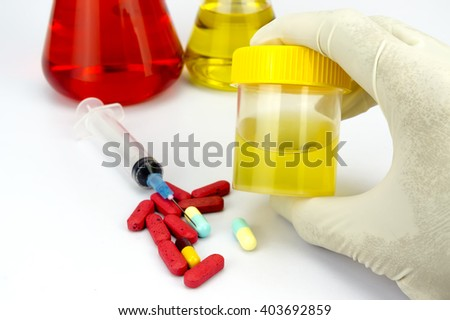 Urine sample bottle, syringe and pills isolated with shallow depth of field (dof) - stock photo