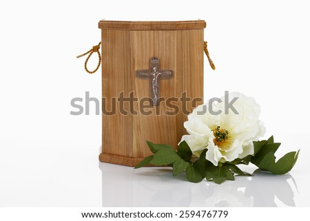Urn from wood and white blossom - stock photo