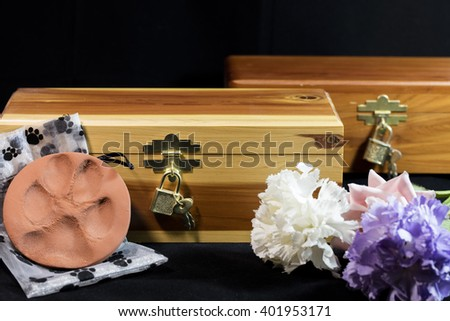 Urn of ashes of a beloved pet who passed away - stock photo